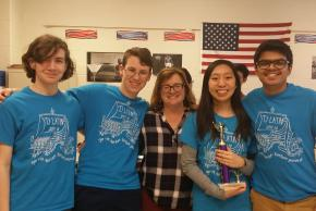 photo of Intermediate Team Latin students and their teacher with their trophy