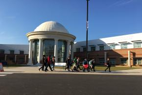 photo of students walking in front of dome