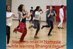 Students relax in Namaste while learning Bhangra dance!